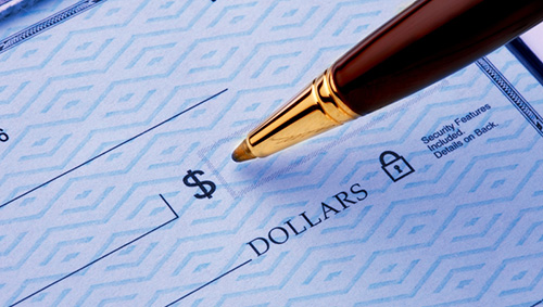 zoomed in photo of a pen writing a check